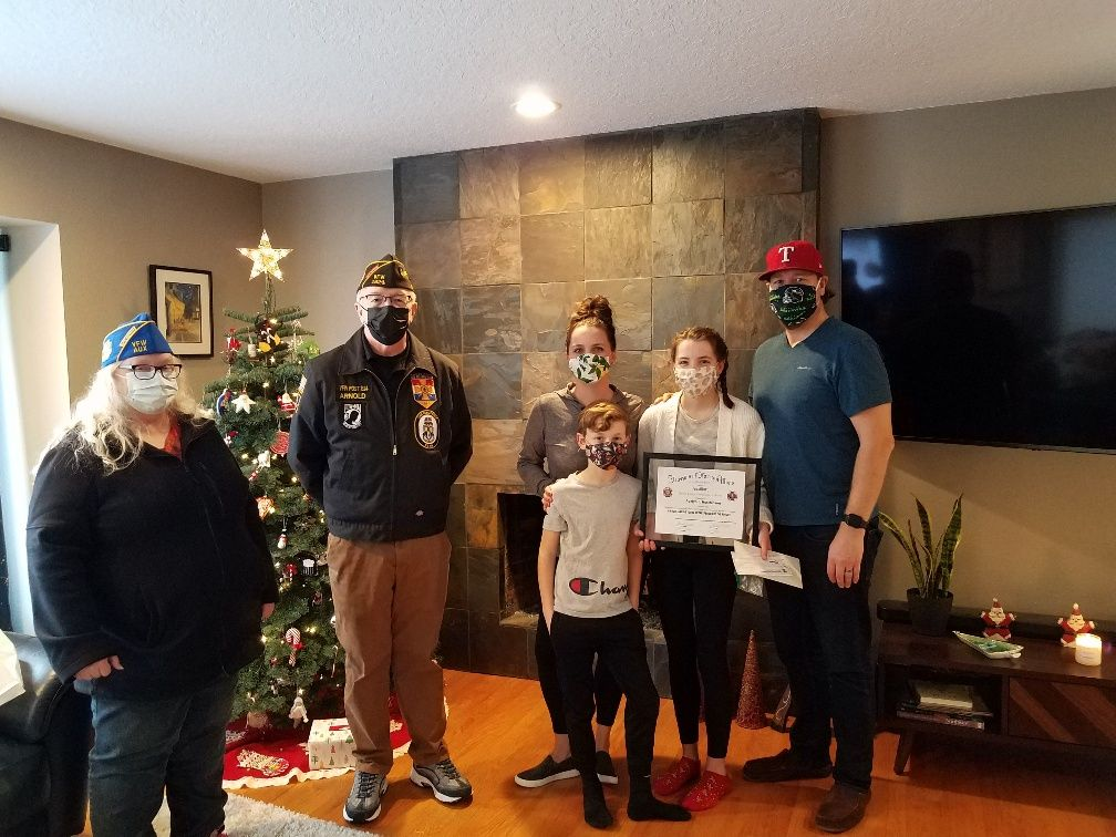 Patriot's Pen First Place Entry for Three Rivers VFW Post 1324 Adelyn Hutchinson & Family, with Auxiliary President Janice Wilson and Post Commander Greg Arnold.